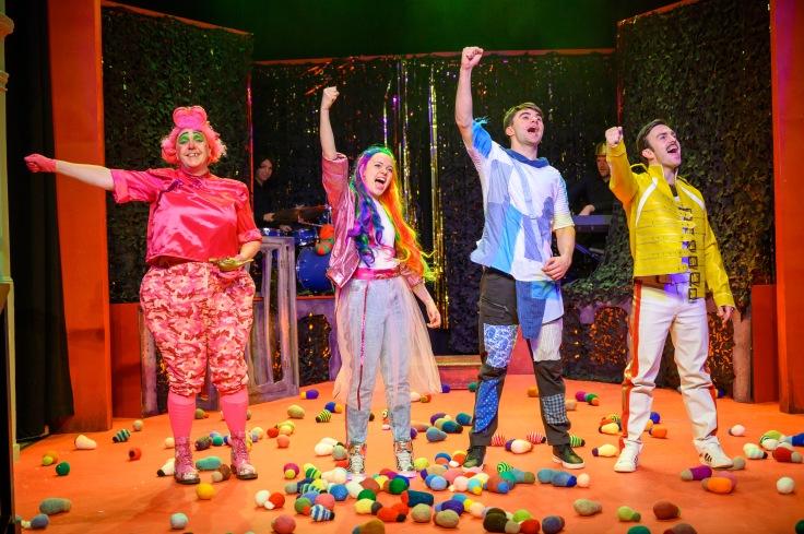 Aladdin Gary Bridgens (Widow Twankey), Emily Arnfield (Jazz Dillydally), Quinn Richards (Aladdin) and Alex Moran (genie) with lightbulbs